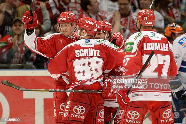 Rok Ticar of Cologne celebrates with teammates during the DEL match between Koelner Haie and Iserlohn Roosters at Lanxess Arena on January 30 2013 in...