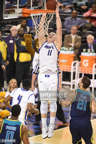 Rokas Gustys of the Hofstra Pride goes for a jam during the Colonial Athletic Conference Championship college basketball game against the North...