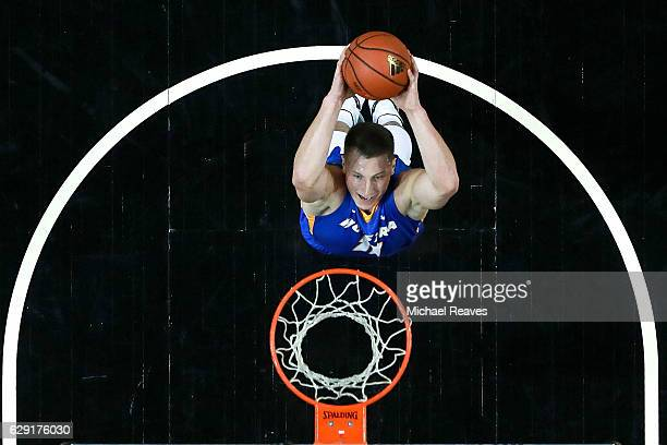 Rokas Gustys of the Hofstra Pride goes up for a dunk against the Kentucky Wildcats in the first half of the Brooklyn Hoops Winter Festival at...