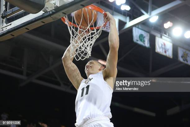 Rokas Ulvydas of the UCF Knights attempts a slam dunk against the Southern Methodist Mustangs during a NCAA basketball game at the CFE Arena on...