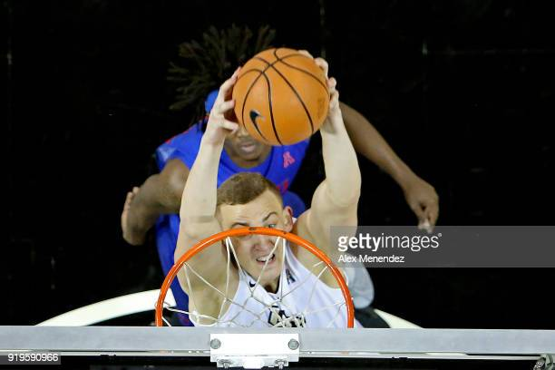 Rokas Ulvydas of the UCF Knights attempts a slam dunk over Elijah Landrum of the Southern Methodist Mustangs during a NCAA basketball game at the CFE...