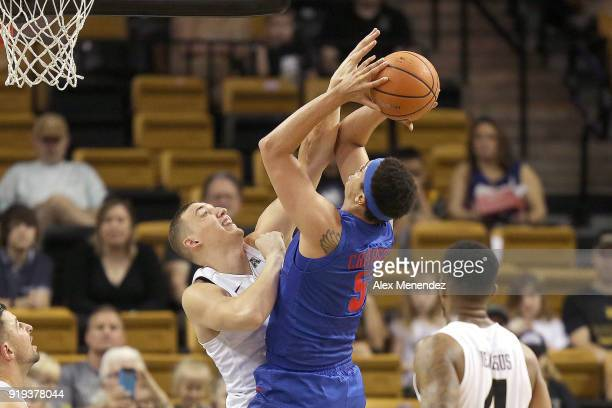 Rokas Ulvydas of the UCF Knights blocks a shot attempt by Ethan Chargois of the Southern Methodist Mustangs during a NCAA basketball game at the CFE...