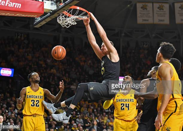 Rokas Ulvydas of the UCF Knights dunks the ball against Markis McDuffie and Shaquille Morris of the Wichita State Shockers during the second half on...