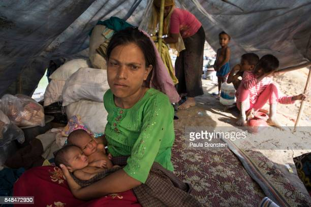 Rokeya Begum holds her 4 day old twins born in a makeshift tent September 17 2017 in Kutupalong Cox's Bazar Bangladesh Over 400000 Rohingya refugees...