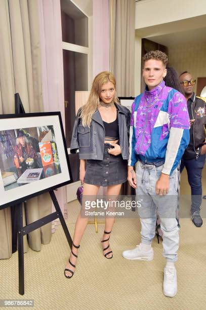 Rola and guest attend Diesel Presents Scott Lipps Photography Exhibition 'Rocks Not Dead' at Sunset Tower on June 28 2018 in Los Angeles California