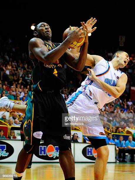 Rolan Roberts of the Crocodiles contests the ball with Craig Bradshaw of the Blaze during the round 15 NBL match between the Townsville Crocodiles...