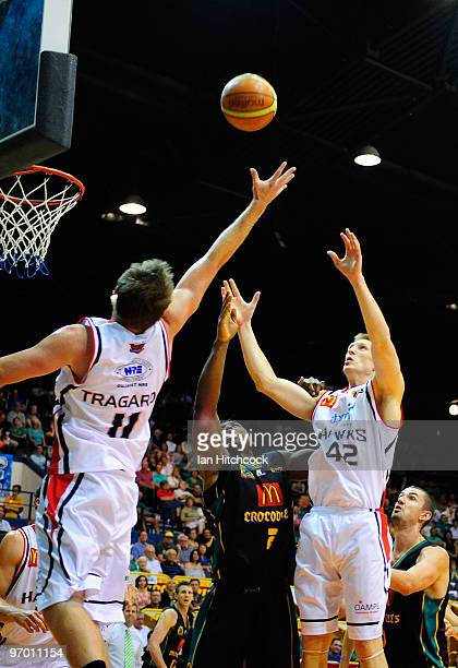 Rolan Roberts of the Crocodiles contsts the ball with Cameron Tragardh and David Gruber of the Hawks during game two of the NBL semi final series...