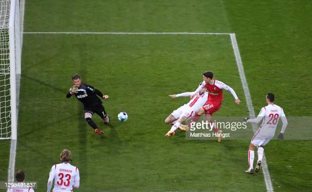 Rolan Sallai of Sport-Club Freiburg scores his team's third goal past Timo Horn of 1. FC Koln during the Bundesliga match between Sport-Club Freiburg...