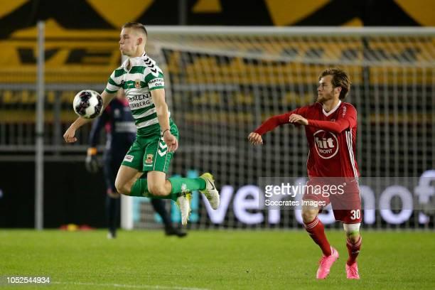 Roland Baas of Go Ahead Eagles James Efmorfidis of Almere City during the Dutch Keuken Kampioen Divisie match between Almere City v Go Ahead Eagles...