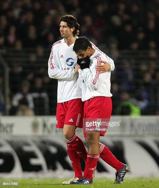 Roland Benschneider and Marvin Matip of Cologne look dejected at the end of the Bundesliga match between Arminia Bielefeld and 1FC Cologne at the...
