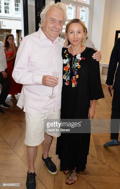 Roland Cowan and wife Jane Cowan attend the Bansky 'Greatest Hits 20022008' exhibition VIP preview at Lazinc on July 9 2018 in London England