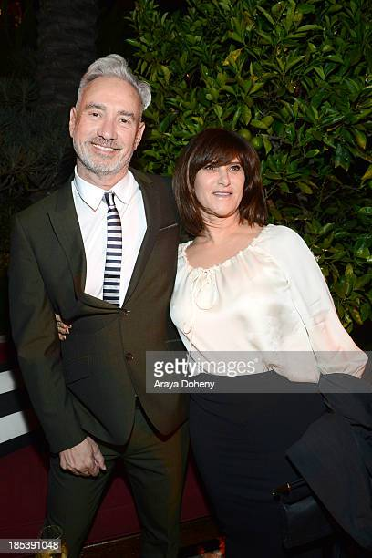 Roland Emmerich and Amy Pascal attend An Evening Under The Stars Benefiting The LA Gay Lesbian Center on October 19 2013 in Los Angeles California