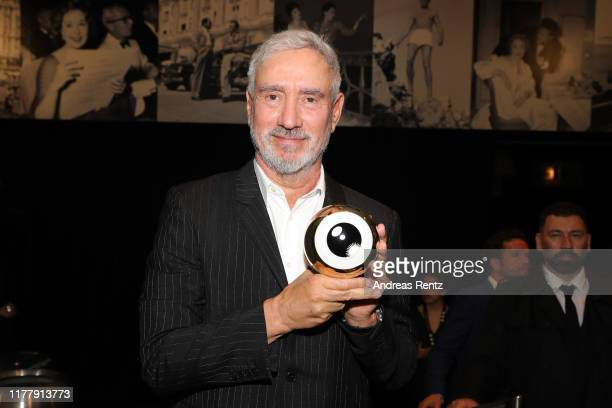 Roland Emmerich speaks on stage after receiving the ZFF Golden Icon Award ahead of the The Day After Tomorrow screening during the 15th Zurich Film...