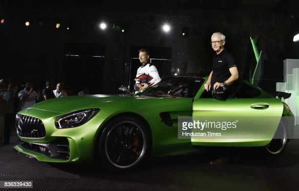 Roland Folger MD CEO MercedesBenz India and AMG Driver Christian Hohenadel at the launch of AMG GT R on August 21 2017 in New Delhi India