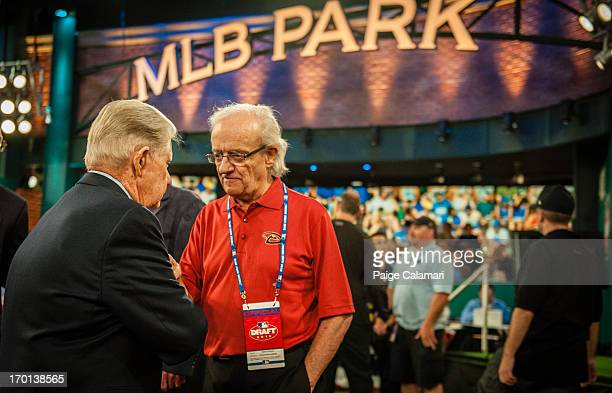 Roland Hemond speaks with Art Stewart during the 2013 FirstYear Player Draft at MLB Network's Studio 42 on June 6 2013 in Secaucus New Jersey