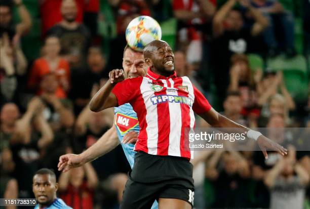 Roland Juhasz of MOL Vidi FC battles for the ball in the air with Danilo Cirino de Oliveira of Budapest Honved during the Hungarian Cup Final match...