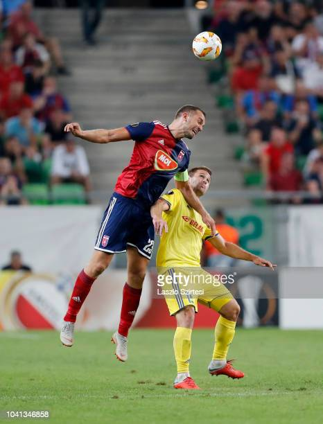 Roland Juhasz of Vidi FC battles for the ball in the air with Maksim Skavysh of FC BATE Borsiov during the UEFA Europa League Group Stage match...