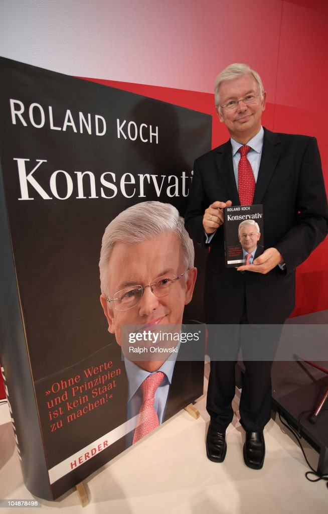 Roland Koch, former governor of the German state Hesse smiles during the presentation of his book 'Konservativ' 'Conservative' during the Frankfurt Book Fair 2010 on October 6, 2010 in Frankfurt am Main, Germany. The Frankfurt book fair, that runs from 6th to 10th October, is the world's largest event of it's type. This year the special theme is 'Literature of Argentina'.