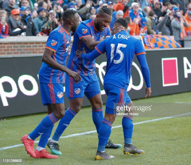 Roland Lamah and Kendall Waston of FC Cincinnati celebrate with Allan Cruz of FC Cincinnati after a goal during the game against the Portland Timbers...