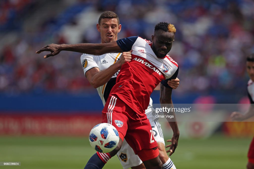 Roland Lamah of FC Dallas fights for the ball with Daniel Steres of LA Galaxy during the Major Soccer League match between Dallas FC and LA Galaxy at Toyota Stadium on May 12, 2018 in Frisco, Texas.
