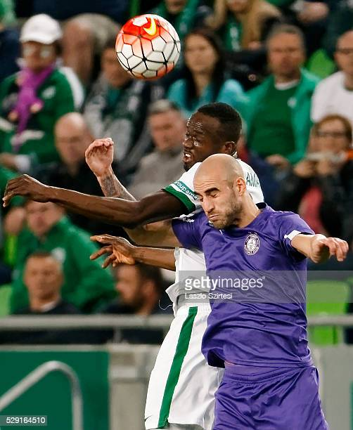 Roland Lamah of Ferencvarosi TC battles for the ball in the air with Jonathan Heris of Ujpest FC during the OTP Bank League football match between...