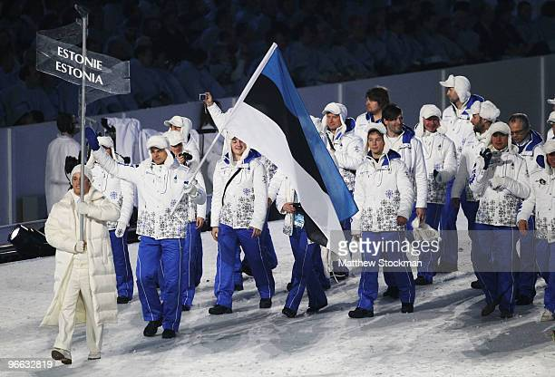 Roland Lessing of Estonia carries the flag during the Opening Ceremony of the 2010 Vancouver Winter Olympics at BC Place on February 12 2010 in...