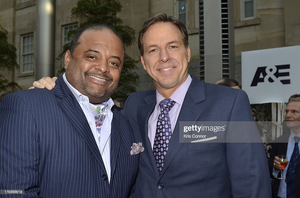 Roland Martin and Jake Tapper pose for a photo during the NCTA Reception hosted by A+E Networks at Smithsonian American Art Museum & National Portrait Gallery on June 11, 2013 in Washington, DC.