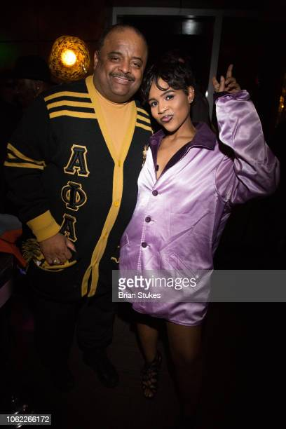 Roland Martin and singer Alex Vaughn attend his 50th birthday celebration at The Park At 14th on November 15 2018 in Washington DC