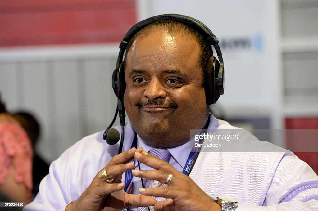 Roland Martin, Managing Editor of TV One, talks with Andrew Wilkow during an episode of The Wilkow Majority on SiriusXM Patriot at Quicken Loans Arena on July 21, 2016 in Cleveland, Ohio.