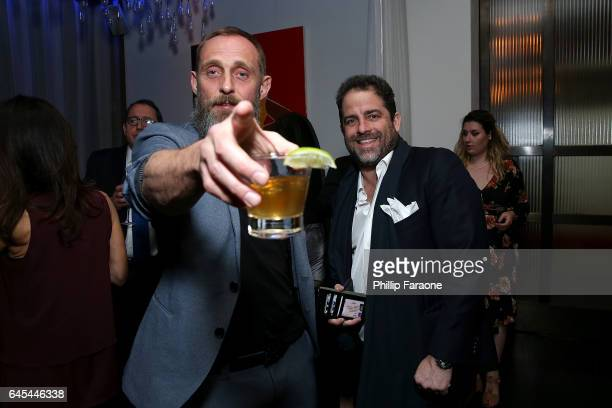 Roland Moller and Brett Ratner attend Sony Pictures Classics' Annual PreAcademy Awards Dinner Party at STK on February 25 2017 in Los Angeles...