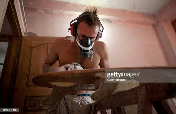 COX'S BAZAR BANGLADESH OCTOBER 23 Roland Moreau makes a surfboard from jute on October 23 2013 in Cox's Bazar Bangladesh Moreau a construction worker...