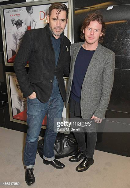 """Roland Mouret and Christopher Kane attend the UK premiere of """"Dior And I"""" at The Curzon Mayfair on March 16, 2015 in London, England."""