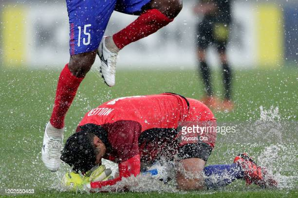 Roland Muller of CeresNegros in action against Adailton of FC Tokyo during the AFC Champions League play off between FC Tokyo and CeresNegros at...