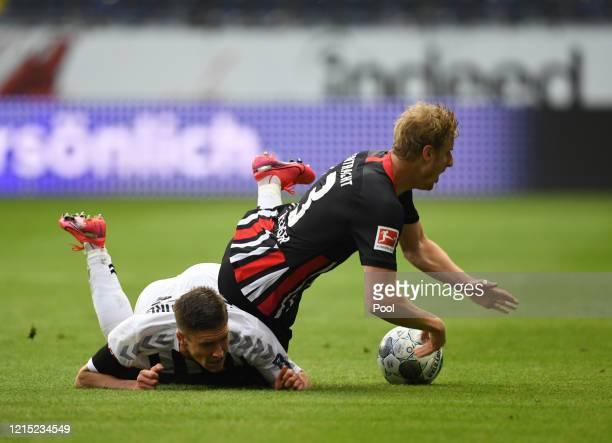 Roland Sallai from Freiburg battles for possession with Martin Hinteregger from Frankfurt during the Bundesliga match between Eintracht Frankfurt and...