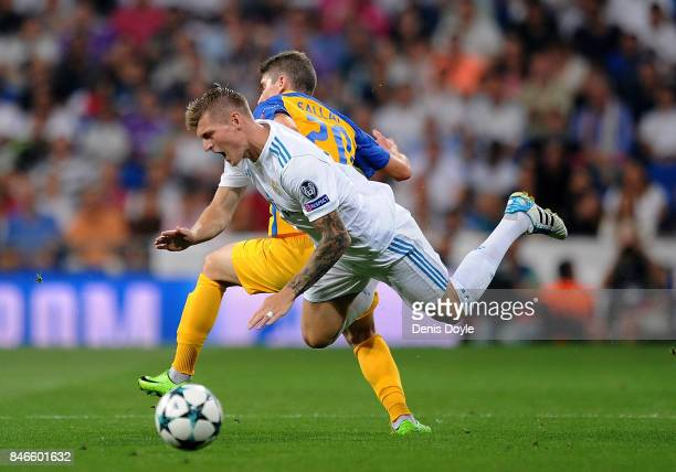 Roland Sallai of Apoel FC fouls Toni Kroos of Real Madrid during the UEFA Champions League group H match between Real Madrid and APOEL Nikosia at...
