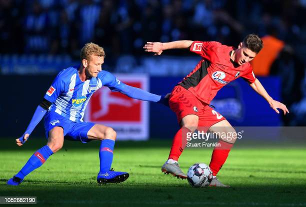 Roland Sallai of Freiburg evades Fabian Lustenberger of Hertha BSC during the Bundesliga match between Hertha BSC and SportClub Freiburg at...