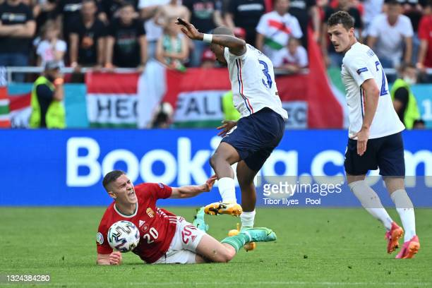 Roland Sallai of Hungary goes down after a challenge from Presnel Kimpembe of France during the UEFA Euro 2020 Championship Group F match between...
