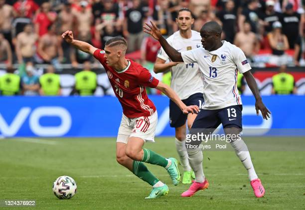 Roland Sallai of Hungary is closed down by N'Golo Kante of France during the UEFA Euro 2020 Championship Group F match between Hungary and France at...
