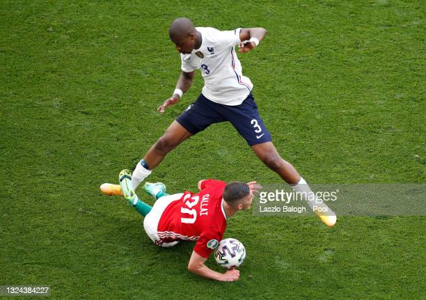 Roland Sallai of Hungary reacts after a challenge by Presnel Kimpembe of France during the UEFA Euro 2020 Championship Group F match between Hungary...