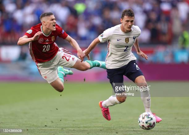 Roland Sallai of Hungary reacts as he is challenged by Benjamin Pavard of France during the UEFA Euro 2020 Championship Group F match between Hungary...