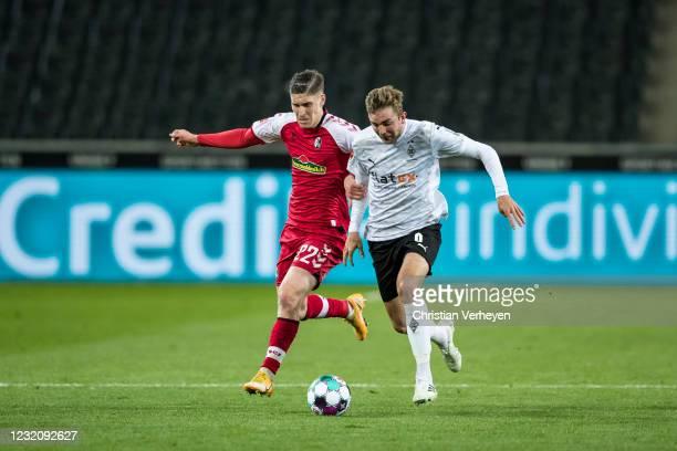 Roland Sallai of SC Freiburg and Christoph Kramer of Borussia Moenchengladbach battle for the ball during the Bundesliga match between Borussia...