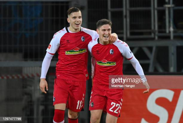 Roland Sallai of SC Freiburg celebrates with team mate Ermedin Demirovic after scoring their side's first goal during the Bundesliga match between...