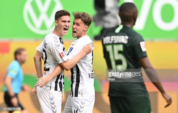 Roland Sallai of Sport-Club Freiburg celebrates after scoring his team's second goal with Luca Waldschmidt of Sport-Club Freiburg next to Jerome...