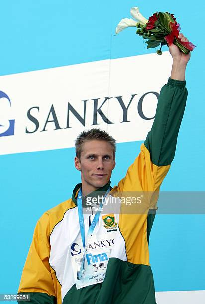 Roland Schoemann of South Africa waves to the crowd after receiving the silver medal in the 100 meter Freestyle final during the XI FINA World...