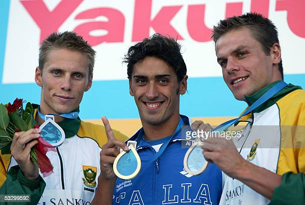 Roland Schoemann of South Africa wins the silver medal Filippo Magnini of Italy wins the gold medal and Ryk Neethling of South Africa wins the bronze...