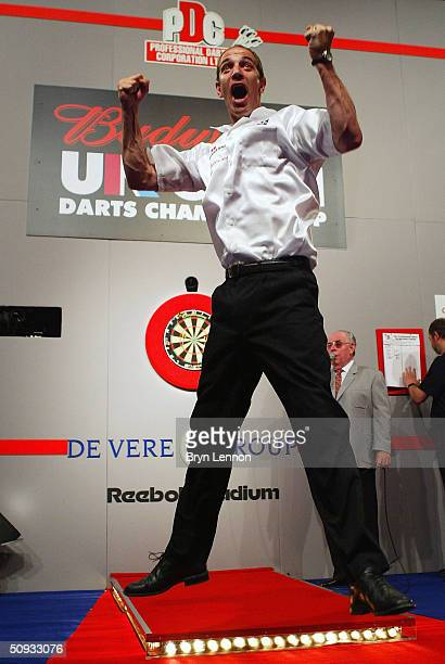 Roland Scholten celebrates winning the Budweiser UK Open Darts Championship on June 6, 2004 at the Reebok Stadium in Bolton, England.
