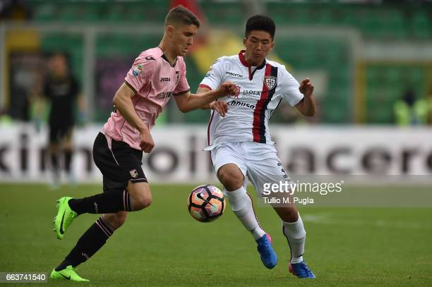 Roland Sellai of Palermo and Kwang Song Han of Cagliari compete for the ball during during the Serie A match between US Citta di Palermo and Cagliari...