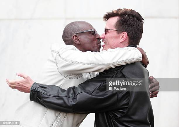 Roland Smith and Paul Mattson of Farmington Hills MI kiss after getting married at the Oakland County Courthouse on March 22 2014 in Pontiac Michigan...