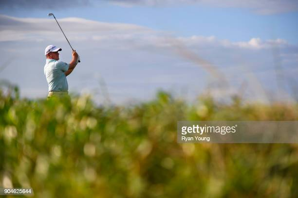 Roland Thatcher plays his shot from the 13th tee during the first round of the Webcom Tour's The Bahamas Great Exuma Classic at Sandals Emerald Bay...