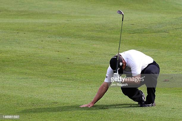 Roland Thatcher reacts after hitting his ball in a bunker of the 18th green during the final round of the 2012 Travelers Championship at TPC River...